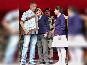 Nana Patekar meets with school children during a visit to BSF camp