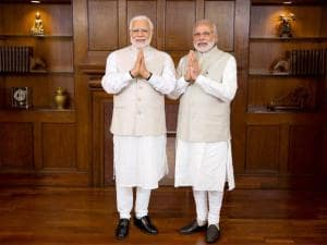 Prime Minster Narendra Modi poses with his wax statue due to be placed at London's Madame Tussauds museum, in New Delhi