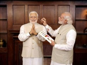 Prime Minster Narendra Modi with his wax statue due to be placed at London's Madame Tussauds museum, in Delhi