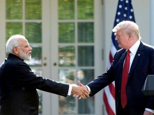 President Donald Trump and Indian Prime Minister Narendra Modi shake hands