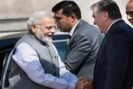 Prime Minister Narendra Modi shakes hands with Tajikistan President Emomali Rahmon