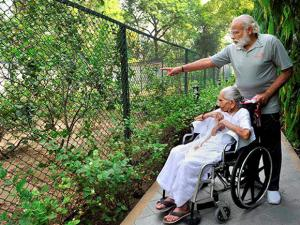 Prime Minister Narendra Modi with his mother Hiraba at the 7RCR in New Delhi during the latter's first visit to the PM's residence