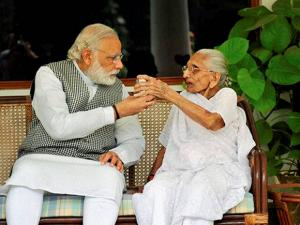 Prime Minister Narendra Modi with his mother Hiraba at the 7RCR in New Delhi during the latter's first visit to the PM's residence (2)
