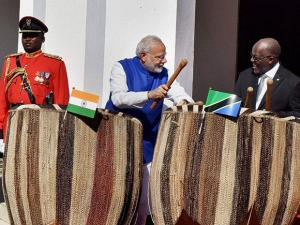 Narendra Modi with Tanzanian President John Magufuli playing drums during the ceremonial welcome