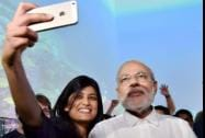 Prime Minister Narendra Modi poses for a photo with students