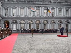 Prime Minister_Narendra Modi reviews a guard of honor along with his Belgian counterpart Charles Michel at a ceremonial welcome at the Egmont Palace in Brussels