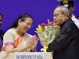 President, Pranab Mukherjee being greeted by Speaker Lok Sabha, Sumitra Mahajan as Vice President, M Hamid Ansari looks on during the inaugural session of the National Conference of Women