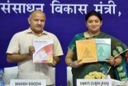 HRD Minister Smriti Irani with Delhi Dy CM Manish Sisodia releasing NCERT books on Yoga