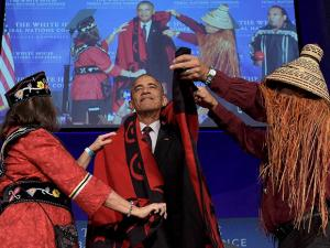 President of National Congress of American Indians, cover President Barack Obama with a blanket