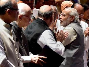 Prime Minister Narendra Modi exchange greetings with MP's of NDA during a meeting