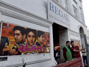 Movie buffs taking selfies in front of  iconic theatre Regal Cinema