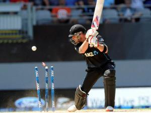 New Zealand's Brendon McCullum is bowled by Australia's James Faulkner for 42