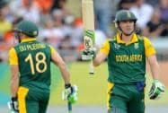 South Africa's AB de Villiers waves his bat after scoring 50 runs