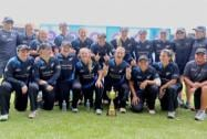 New Zealand women cricketers pose for a group photo with T20 trophy