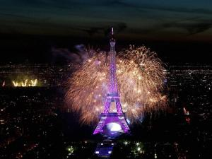Fireworks illuminate the Eiffel Tower in Paris during Bastille Day celebrations