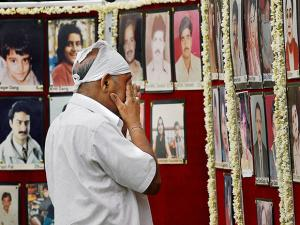 A man paying tribute to Uphaar tragedy victims on the 19th anniversary of the incident