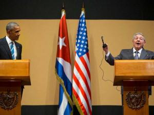 Cuban President Raul Castro gestures as he calls to an end his joint news conference with President Barack Obama at the Palace of the Revolution in Havana, Cuba