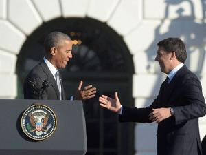 Barack Obama and Matteo Renzi stand on stage during a state arrival ceremony