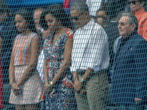 Barack Obama,Michelle, stand with Cuba's President Raul Castro during a moment of silence for the victims of attacks in Brussels, Belgium