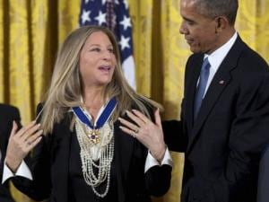 President Barack Obama presents the Presidential Medal of Freedom to Barbra Streisand