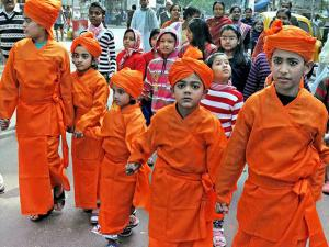 Children dressesd as Swami Vivekananda participate in a procession during his 154th birth anniversary celebrations at his ancestral house in Kolkata