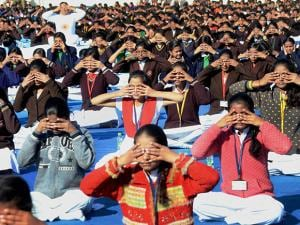 School children participate in mass 'Surya Namaskar' programme organised