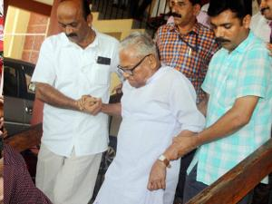 LDF veteran VS Achuthanandan is escorted by supporters after he won the Assembly polls in Palakkad