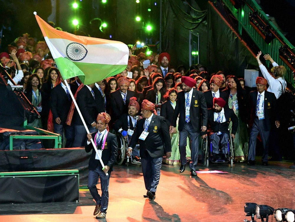 Ace shooter, Vijay Kumar, holds, Tricolour, leads, Indian contingent, Celtic Park, opening ceremony, Commonwealth Games, Glasgow, Scotland