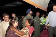 Rescued people arrive by an IAF plane at AFS Palam in New Delhi