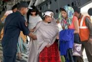 Rescued persons from quake-hit Nepal de-boarding an IAF transport aircraft, at Palam airport