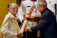 President Pranab Mukherjee presents Padma Shri to renowned historian N Purushothama Mallaya during Padma Awards 2015
