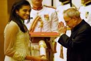 President Pranab Mukherjee presents Padma Shri to P V Sindhu during Padma Awards 2015