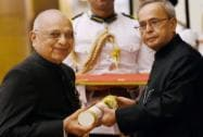 President Pranab Mukherjee presents Padma Bhushan to author and constitutional expert Subhash C Kashyap