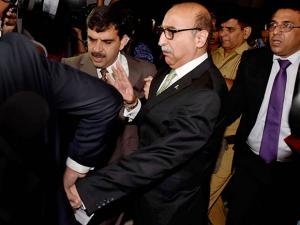 Pakistan's High Commissioner Abdul Basit leaves after attending a programme of Centre for Peace and Progress in New Delhi
