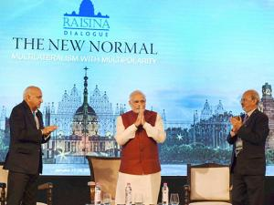 Prime Minister Narendra Modi with Minister of State for External Affairs,M.J. Akbar and ORF Director Sunjoy Joshi  at the Opening Session of the Second Raisina Dialogue