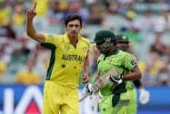Australia's Mitchell Starc, left, celebrates after taking the wicket of Pakistan's Sarfaraz Ahmed