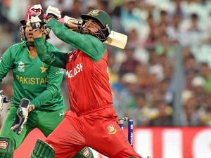 Bangladesh's batsman Tamim Iqbal plays a shot during World Cup T20 match against Pakistan at Eden Gardens in Kolkata