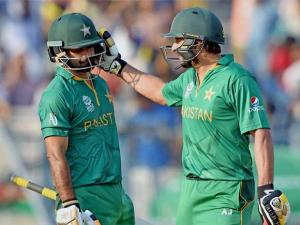 Pakistan's Captain Shahid Afridi congratulates teammate Mohammad Hafeez on his half century during ICC T20 World cup match against Bangladesh