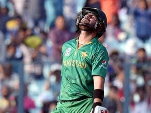Pakistani batsman A Shazad celebrates his half century during World Cup T20I match against Bangladesh at Eden Gardens in Kolkata
