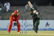 Baber Azam,  plays a shot as Zimbabwe wicketkeeper Richmond Mutumbami