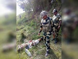 BSF men near the body of suspicious Pak intruder who was killed while trying to cross the border at Ooctroi Post in R S Pura Sector