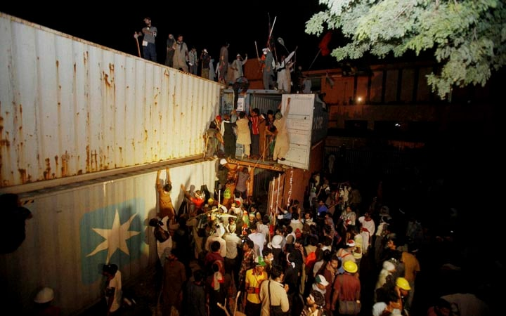 Pakistani, protesters, climb, shipping, containers, march, toward, prime minister's, home