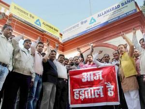 Bank employees hold demonstration outside a bank as the United Forum of Bank Unions (UFBU) goes on a nation-wide strike, in Allahabad