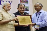Prime Minister Narendra Modi present the E-Panchayat Award to Additional Chief Secretary of Assam V K Pipersenia