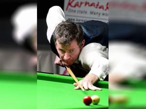 Peter Gilchrist of Singapore plays against India's Pankaj Advani