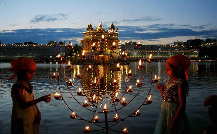 Children, light, lamps, occasion, 410th, installation, anniversary, Sri, Guru, Granth, Sahib, holy, book, Sikh, religion, Golden, Temple, Amritsar