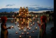 Children light lamps on the occasion of 410th installation anniversary of Sri Guru Granth Sahib