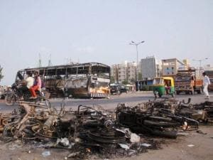The charred remains of the vehicles in Ahmedabad