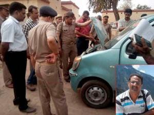 Police personnel checking the car of NIA officer Mohammed Tanzil (inset) who was shot dead by unidentified assailants on Saturday night as he was on his way back from a function with his wife and two chil