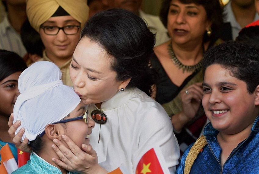 China's, first lady, Peng Liyuan, kisses, student, visit, Tagore International School, New Delhi